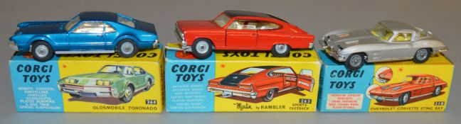 3 Corgi Toys, 263 Nash Rambler Sports Fastback in red/black, 264 Oldsmobile Tornado and 310