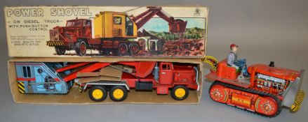 An  SSS International Toys (Japan) Revolving Power Shovel on Diesel Truck,  an impressive tinplate