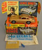 A Corgi Toys 261 James Bond 007 Aston Martin DB5, G/G+ in a generally G+ box and plinth with