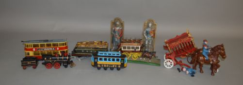 A mixed lot which includes; a cast iron Locomotive with tender and figures, a cast iron horse