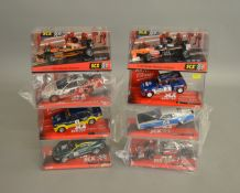 8 boxed SCX slot cars, which includes; #62060 Aston Martin DBR-9, #62680 Dodge Charger etc (8)