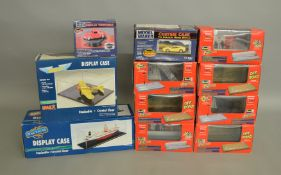 11 boxed variously sized acrylic Model Display Cases by Revell, IMex and Model Maker. (11)