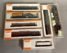 Ex-Shop Stock N gauge Arnold x7 which includes coaches and rolling stock; #3110 x3  #4650, etc (7)