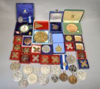 A large quantity of National Rifle Association medals/medallions (28) together with other