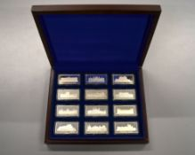 A set of twelve silver ingots commemorating British Royal palaces/homes etc to include Buckingham