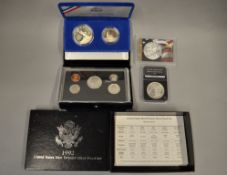 A boxed quantity of uncirculated American silver coins to include 1885 Dollar, $1 fine silver eagle,