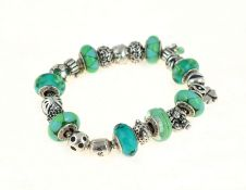 PANDORA - A silver Pandora bracelet, with twenty two Pandora charms/stoppers, approx gross weight