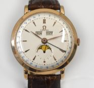 OMEGA - A rare early 1950's gents 18ct gold Omega Cosmic Triple Calendar Moonphase mechanical
