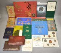 A boxed quantity of world proof & uncirculated coin sets