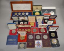 A boxed quantity to include coins & medallions from around the world, some Royal Mint