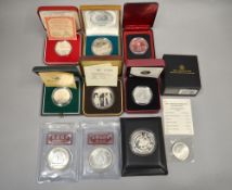 A boxed quantity of foreign silver proof coins/medallions to include £1 Australian Kookaburra, $10
