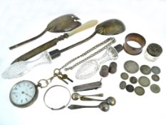 A boxed quantity of assorted silver to include a salad spoon, pen knife, napkin ring, key wind