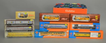 HO Gauge. A boxed Roco 2 car Tram together with various boxed Wagons by Liliput, Roco and