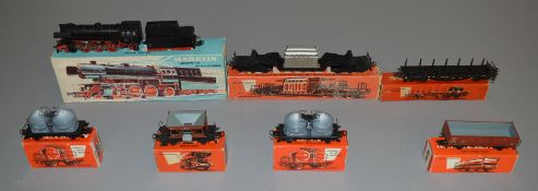 HO Gauge. A boxed Marklin 3005 Locomotive together with 6 boxed items of Rolling Stock, 4516,