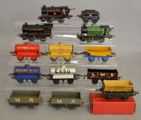 O Gauge. 3 unboxed Hornby 0-4-0 Tank Locomotives, including two in black, one with Tender and