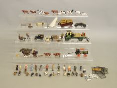 O Gauge. Over 50 unboxed plastic and metal animal and people figures together with six metal