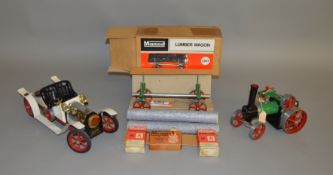 LIVE STEAM. A boxed Mamod LW.1 Lumber Wagon in green with three 'log' load together with an unboxed