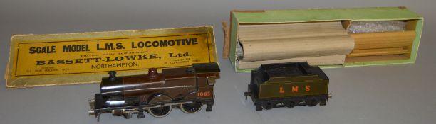 O Gauge. A boxed Bassett Lowke LMS 4-4-0 Locomotive '1063' with six wheel Tender, appears