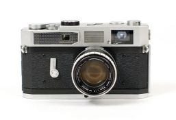 Canon Model 7 Rangefinder Camera #888470 with Canon Lens 50mm f1.8 #322333. Meter working. (Spring