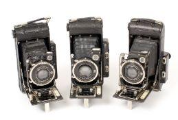 Three Ensign Autorange 120 Folding Cameras. Various lens & shutter combinations, including one