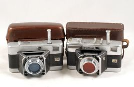Pair of Voigtlander 'Barn Door' Vitessa Cameras. Original model and a metered Vitessa L, each with