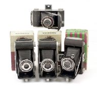 Four Ensign Ranger Folding Roll Film Cameras. Ranger, boxed (condition 6F); 2x Ranger II, boxed (