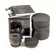Black Leica Summilux-M 28mm f1.4 ASPH Lens. #4206082. With hood, caps, pouch, instructions etc in
