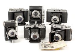 A Box of Six Various Rangefinder Cameras. Comprising Agfa Isolette III, Solida II (Made in Germany