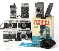 Seven Yashica Compact Film Cameras. Comprising Two Yashica Sequelle camera, one as new, boxed;