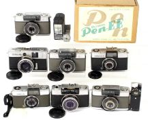Eight Olympus Half Frame Cameras. Comprising Pen EEn, boxed with flash, filters, case etc.; Pen S (