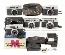 Five Minolta Half Frame Cameras. Comprising Repo, boxed with instructions, case, etc; Repo & case;