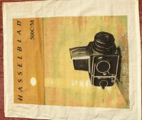An Unusual Wall-Hanging Cotton Hasselblad Advertising 'Poster'. Aprox 80x70cms, hemmed top and