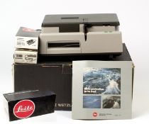 Leica Pradovit 153DU 35mm Slide Projector. With 90mm f2.8 lens, remote, instructions etc. In