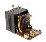 A Good Thornton Pickard Folding Ruby 1/4 Plate Wood & Brass Camera. (condition 5F).