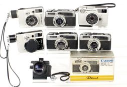 Six Canon Half Fame Cameras. Comprising 2x Demi, one boxed, one not firing; Dial 352 (shutter