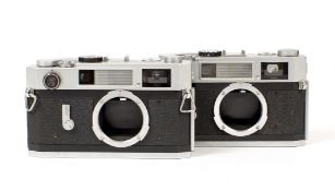 A Pair of Canon Model 7s Rangefinder Camera Bodies. #10042 with working meter, needs battery (