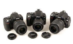 Two Nikon D40 DSLRs & a D60, Each with Nikkor AF Lens.