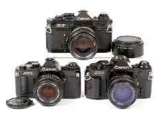 Three Canon Film Cameras, Two with 50mm f1.4 Lens. Comprising Black Canon EF #220087 with breech-