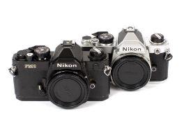 Nikon FM and FE2 Camera Bodies. Comprising chrome FM body #3041797 and black FM2 body #7159486. (