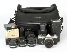 Olympus OM-2n Outfit including 24mm Lens. Comprising OM-2n (condition 5/6F) with 50mm f1.8, 24mm