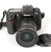Nikon D300 DSLR & 12-24mm AF Lens. Body #8017492 (condition 5/6E) with battery (no charger).