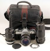 Canon AE-1 Four-Lens Outfit. Comprising AE-1 body with FAST FD 35mm f2 SSC lens (condition 4/5F); FD