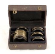 A Darlot, Paris Brass Lens Casket Set. Comprising lens with built-in rotary Waterhouse Stops (rear