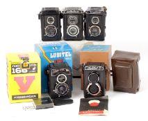 Five Voigtlander, Lomo & Lubitel TLRs. To include Lubitel 166U (condition 3/4F) in makers box,