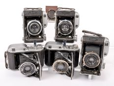 Five Ensign 220 Autorange Folding Rangefinder Cameras. Various lens and shutter combinations, one in