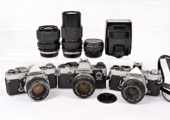 Olympus OM-1 & OM10 SLR Outfit. Comprising OM-1 MD, OM-1n MD & OM10 (with Manual Adapter) bodies,