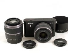 Nikon J1 Mirrorless Digital Camera Set.