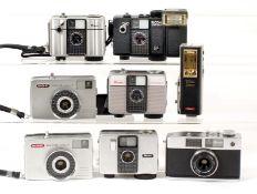 Seven Ricoh Half Frame Cameras. Comprising Ricoh Auto Half (battery leakage damage); Auto Half SE;