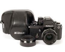 Black Nikon F2S Photomic with Nikon 50mm f2 Pre-Ai Lens. #F2 body #7157083, lens #3276233. (