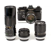 Black Canon FTb QL 4-Lens Outfit. Comprising body #369124 with FD 50mm f1.4 lens (condition 5F) &